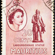 MAURITIUS - CIRCA 1953: A stamp printed in Mauritius shows Labourdonnais statue and portrait of Queen Elizabeth II, circa 1953. — Stock Photo