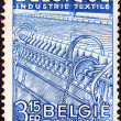 "图库照片: BELGIUM - CIRC1948: stamp printed in Belgium from ""National Industries"" issue shows Textile industry, circ1948."