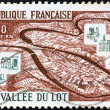 "图库照片: FRANCE - CIRC1974: stamp printed in France from ""Tourist Publicity"" issue shows Lot Valley, circ1974."