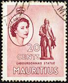 MAURITIUS - CIRCA 1953: A stamp printed in Mauritius shows Labourdonnais statue and portrait of Queen Elizabeth II, circa 1953. — Stock Photo