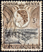 KENYA UGANDA TANGANYIKA - CIRCA 1954: A stamp printed in Kenya Uganda Tanganyika shows Owen falls dam and Queen Elizabeth II, circa 1954. — Stock Photo