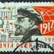 USSR - CIRCA 1966: A postage stamp printed in USSR shows Russian Marxist revolutionary and communist politician Vladimir Ilyich Lenin and the year of the October revolution (1917), circa 1966. — Stock Photo