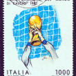 ITALY - CIRCA 1982: A stamp printed in Italy issued for Italy&#039;s World Cup Football Victory shows footballer holding aloft World Cup, circa 1982. - Stock Photo