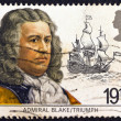 Stock Photo: UNITED KINGDOM - CIRCA 1982: A second class stamp printed in United Kingdom shows admiral Robert Blake and his flagship Triumph, circa 1982.