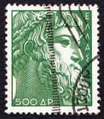 GREECE - CIRCA 1954: A stamp printed in Greece shows god Zeus statue which was found at Artemisio cape, circa 1954. — Stock Photo