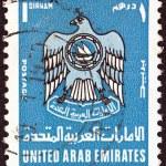 UNITED ARAB EMIRATES - CIRCA 1977: A stamp printed in United Arab Emirates shows an eagle (U.A.E. emblem), circa 1977. — Stock Photo