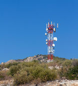 Telecommunication tower on a hill — Stock Photo