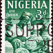 NIGERIA - CIRCA 1961: A stamp printed in Nigeria shows Oyo carver, circa 1961. - Stock Photo