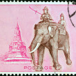 THAILAND - CIRC1970: stamp printed in Thailand shows Queen Suriyothai riding elephant and PhrChedi Sisuriyothai memorial in background, circ1970. — Stock Photo #21257821