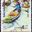 "THAILAND - CIRCA 1971: A stamp printed in Thailand from the ""Visit ASEAN (Association of South East Asian Nations) Year"" issue shows a floating market, Wat Sai, circa 1971. — Stock Photo"