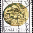 "GREECE - CIRCA 1976: A stamp printed in Greece from the ""Ancient Sealing-stones"" issue shows an onyx sealing stone from 14th century B.C. displaying a lion attacking bull, circa 1976. — Stock Photo"