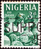 NIGERIA - CIRCA 1961: A stamp printed in Nigeria shows Oyo carver, circa 1961. — Stock Photo