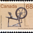 "CANADA - CIRCA 1982: A stamp printed in Canada from the ""Heritage Artifacts"" issue shows a Spinning wheel, circa 1982. — Stock Photo"