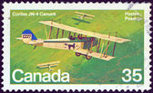 "CANADA - CIRCA 1980: A stamp printed in Canada from the ""Canadian Aircraft (2nd series)"" issue shows a Curtiss JN-4 Canuck biplane, circa 1980. — Stock Photo"