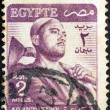 Stock Photo: EGYPT - CIRC1953: stamp printed in Egypt shows farmer, circ1953.