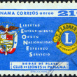 Foto de Stock  : PANAM- CIRC1961: stamp printed in Panamissued for 25th anniversary of Lions Club shows Lions emblem, arms and slogan, circ1961.