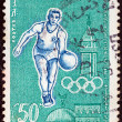 "TUNISIA - CIRCA 1960: A stamp printed in Tunisia from the ""17th Olympic Games, Rome"" issue shows Handball player and minaret., circa 1960. — Stock Photo #22405711"