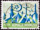 """印度尼西亚-大约 1969年: 从""""五年发展计划""""的问题在印度尼西亚打印戳记表明,宗教标志,大约 1969年. — 图库照片"""