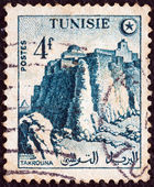 TUNISIA - CIRCA 1954: A stamp printed in Tunisia shows Takrouna ramparts, circa 1954. — Stock Photo