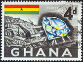 GHANA - CIRCA 1959: A stamp printed in Ghana shows a diamond and mine, circa 1959. — Stock Photo