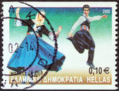 "GREECE - CIRCA 2002: A stamp printed in Greece from the ""Greek Dances"" issue shows Balos dance, Aegean islands, circa 2002. — Stock Photo"
