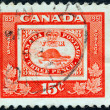 CANADA - CIRCA 1951: A stamp printed in Canada issued for the centenary of First Canadian Postage Stamp shows reproduction of first Canadian stamp of 1851 (beaver), circa 1951. — Stock Photo