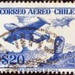 Постер, плакат: CHILE CIRCA 1956: A stamp printed in Chile shows De Havilland Venom FB 4 and Easter Island monolith circa 1956