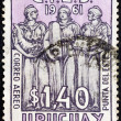 ストック写真: URUGUAY - CIRC1961: stamp printed in Uruguay issued for Latin-AmericEconomic Commission Conference, Puntdel Este shows Welfare, Justice and Education, circ1961.