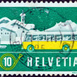 SWITZERLAND - CIRCA 1953: A stamp printed in Switzerland shows Mail Alpine Postal Coach and Winter Landscape, circa 1953. - Stock Photo