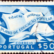 PORTUGAL - CIRCA 1954: A stamp printed in Portugal issued for 's Education Plan shows book, circa 1954. — Stock Photo