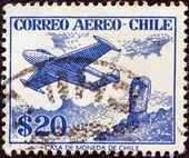 CHILE - CIRCA 1956: A stamp printed in Chile shows De Havilland Venom FB.4 and Easter Island monolith, circa 1956. — Stock Photo