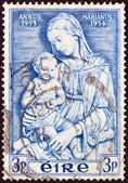 "IRELAND - CIRCA 1954: A stamp printed in Ireland from the ""Marian Year"" issue shows Madonna and Child (Luca Della Robbia), circa 1954. — Stock Photo"