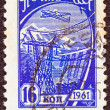 "USSR - CIRCA 1961: A stamp printed in USSR from the ""tenth definitive"" issue shows an airliner over a Hydro-electric station, circa 1961. - Stock Photo"