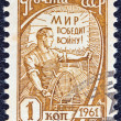 "USSR - CIRCA 1961: A stamp printed in USSR from the ""tenth definitive"" issue shows a driver of combine-harvester, circa 1961. - Stock Photo"