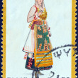"GREECE - CIRCA 1974: A stamp printed in Greece from the ""Traditional Greek Costumes 3rd part"" issue shows a woman from Edipsos, circa 1974. — Stock Photo"