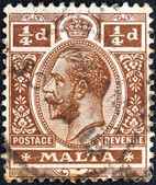 MALTA - CIRCA 1914: A stamp printed in Malta shows King George V, circa 1914. — Stock Photo