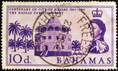 BAHAMAS - CIRCA 1961: A stamp printed in the Bahamas issued for the centenary of city of Nassau shows Nassau Public Library and Queen Elizabeth II, circa 1961. — Stock Photo