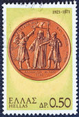 "GREECE - CIRCA 1971: A stamp printed in Greece from the ""150th Anniversary of War of Independence (1st issue). The Church"" shows warriors taking the oath on a medal, circa 1971. — Foto de Stock"
