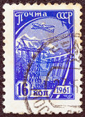 "USSR - CIRCA 1961: A stamp printed in USSR from the ""tenth definitive"" issue shows an airliner over a Hydro-electric station, circa 1961. — Stock Photo"