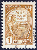 "USSR - CIRCA 1961: A stamp printed in USSR from the ""tenth definitive"" issue shows a driver of combine-harvester, circa 1961. — Stock Photo"