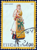 """GREECE - CIRCA 1974: A stamp printed in Greece from the """"Traditional Greek Costumes 3rd part"""" issue shows a woman from Edipsos, circa 1974. — Stock Photo"""
