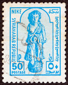 SYRIA - CIRCA 1976: A stamp printed in Syria shows an ancient Statue of Nike, circa 1976. — Stock Photo