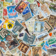 Collection of various stamps background - Stock Photo