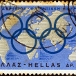 Foto Stock: GREECE - CIRC1967: stamp printed in Greece issued for 6th April, Olympic day shows Olympic Rings and globe, circ1967.