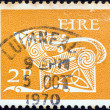 IRELAND - CIRCA 1971: A stamp printed in Ireland shows a dog from an ancient artwork, circa 1971. — Stock Photo #25193997