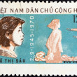 "VIETNAM - CIRCA 1970: A stamp printed in North Vietnam from the ""25th anniversary of Democratic Republic of Vietnam"" issue shows heroine Vo Thi Sau facing firing squad, circa 1970. — Stock Photo"