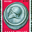 Stock Photo: GREECE - CIRC1969: stamp printed in Greece issued for 20th anniversary of NATO alliance shows ancient Coin of Kamarina, circ1969.