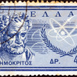 "GREECE - CIRCA 1961: A stamp printed in Greece from the ""Inauguration of Democritus Nuclear Research Centre, Aghia Paraskevi"" issue shows ancient Greek philosopher Democritus, circa 1961. — Stock Photo"