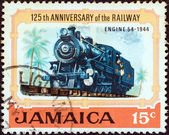"JAMAICA - CIRCA 1970: A stamp printed in Jamaica from the ""125th anniversary of Jamaican Railways"" issue shows Steam locomotive No. 54 (1944), circa 1970. — Stock Photo"