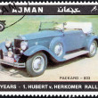 "AJMAN EMIRATE - CIRCA 1970: A stamp printed in United Arab Emirates from the ""65th Anniversary of the Hubert V. Herkomer Rallye"" issue shows Packard-833 of 1930, circa 1970. - Stock Photo"